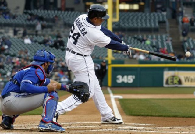 Detroit Tigers Miguel Cabrera (R) singles to left field during the first inning of their MLB American League baseball game against the Toronto Blue Jays in Detroit,  Michigan April 10, 2013.   REUTERS/ Rebecca Cook  (UNITED STATES - Tags: SPORT BASEBALL) - RTXYGXG